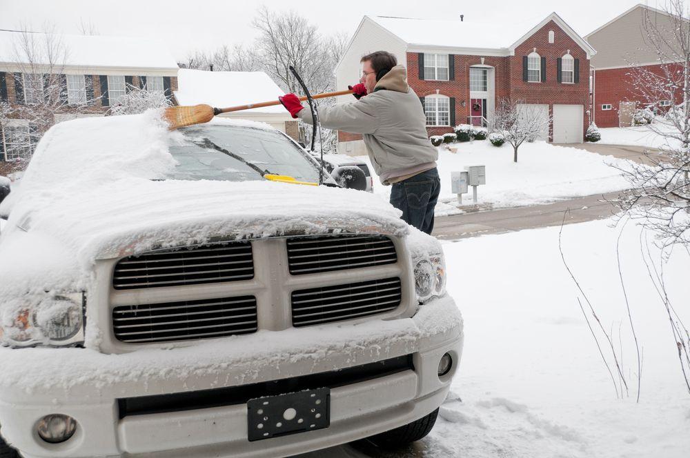 brushing snow off truck