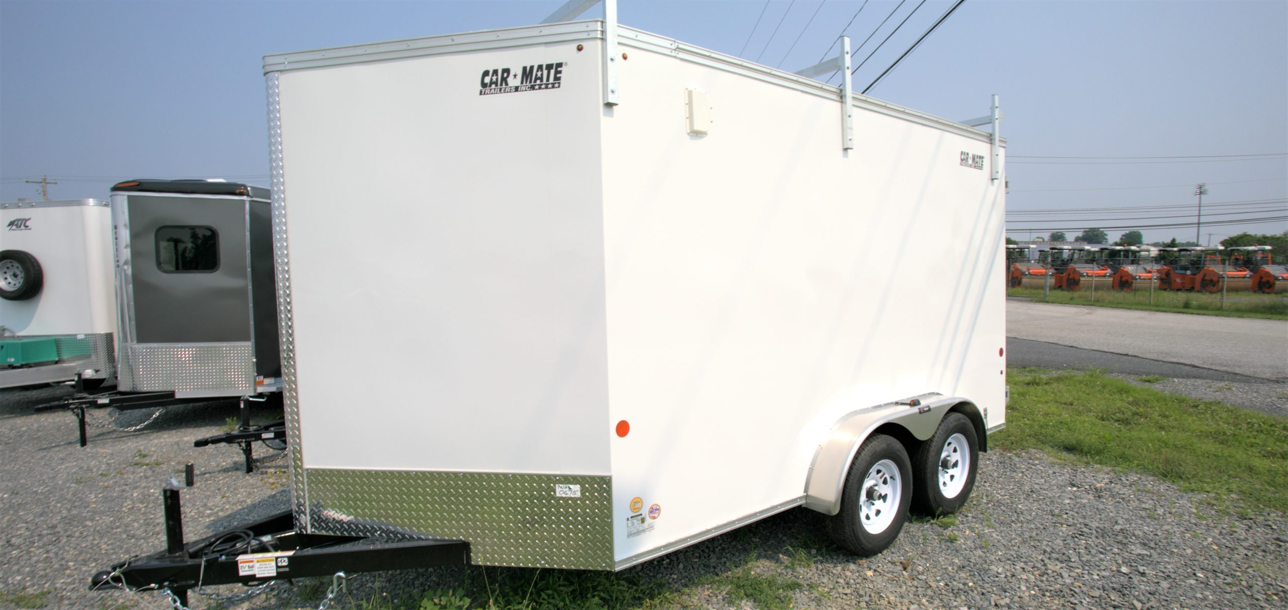 outside of Car Mate White trailer with V-nose