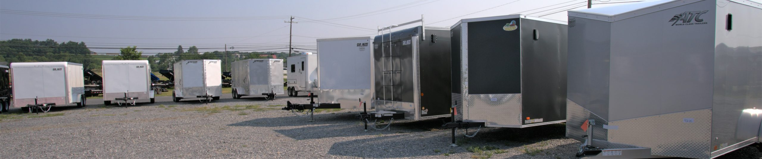 several enclosed cargo trailers parked